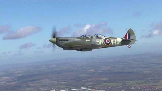 spitfire takes to the air to mark 80th anniversary of plane's first flight air to air shot spitfire in flight back view pilot in cockpit - air to air shot stock videos and b-roll footage