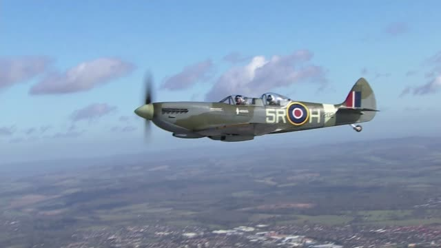 spitfire takes to the air to mark 80th anniversary of plane's first flight air to air shot spitfire in flight - air to air shot stock videos and b-roll footage