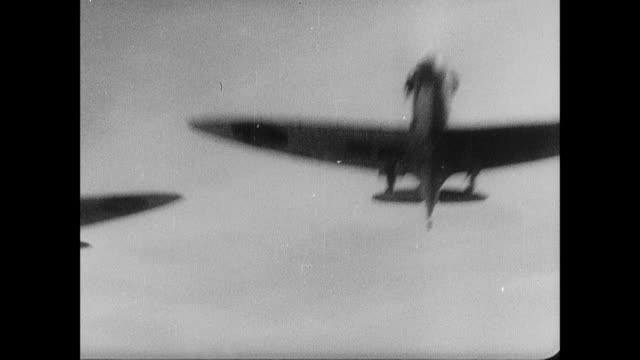 b/w spitfires taking off and chasing retreating luftwaffe ju 88 bomber / rosyth, scotland, united kingdom - aereo militare video stock e b–roll