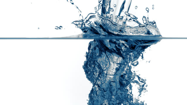 slo mo of splash of water being poured into clear water - water stock videos & royalty-free footage