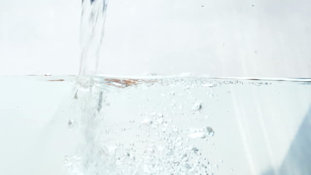 splash of water being pouring into water - filling stock videos & royalty-free footage