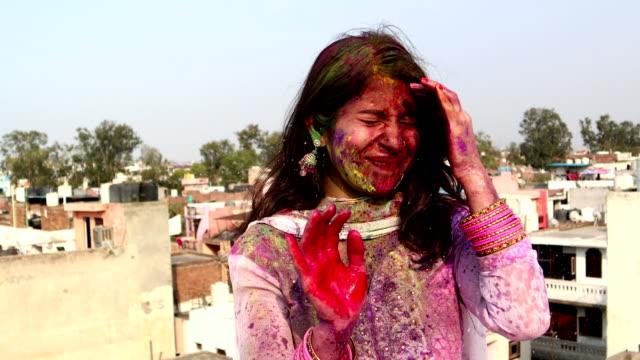 splash of water on female during holi celebration, india - celebratory event stock videos & royalty-free footage