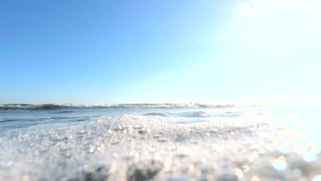 Splash wave on the beach -4K-