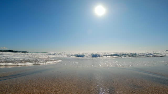 splashes of wave and sun on blue sky - low angle view stock videos & royalty-free footage
