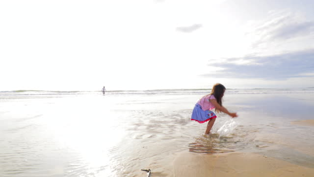 splashing at the beach - part of a series stock videos & royalty-free footage