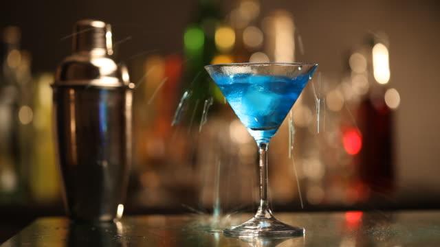 splashing cocktail - drinking glass stock videos & royalty-free footage