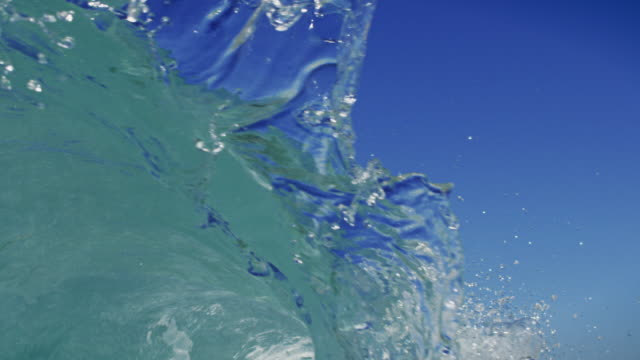a splashing detailed wave breaks over camera in pov on shallow sand beach in the california summer sun. shot in slow motion on the red dragon at 150fps in 4k. - approaching stock videos & royalty-free footage