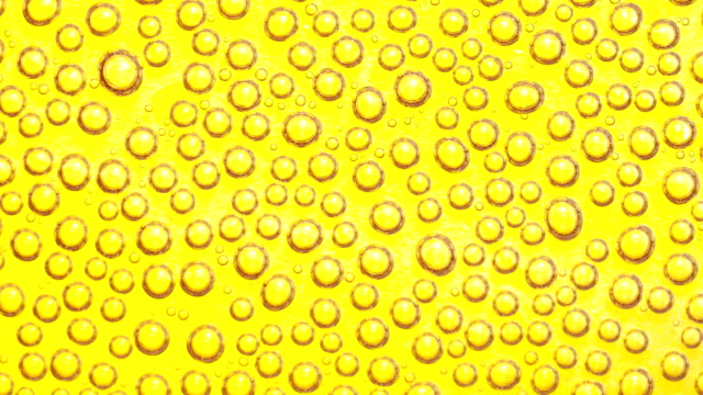splashing droplet yellow color background - splashing droplet stock videos and b-roll footage