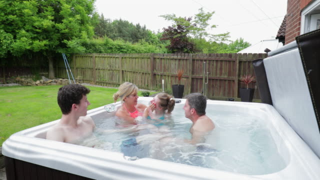 splashing in the hydrotherapy hot tub - hot tub stock videos & royalty-free footage