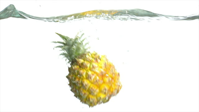 slo mo splashing pineapple close-up - textfreiraum stock videos & royalty-free footage