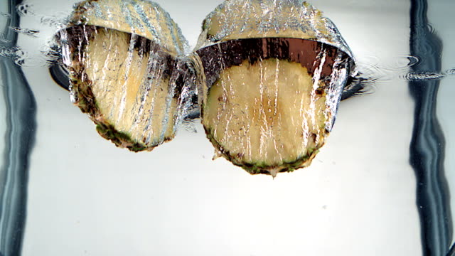 パイナップルのしぶき - みずみずしい点の映像素材/bロール