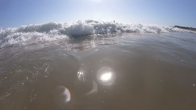 splashing sea water with foam and bubbles - cascais stock videos and b-roll footage