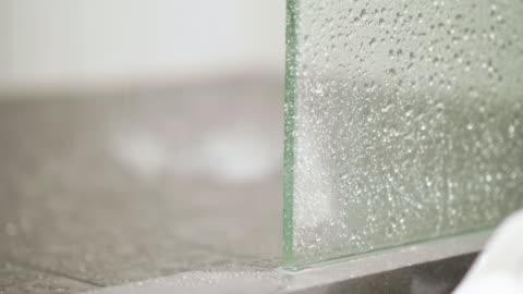splashing water on tiled shower floor - bathroom stock videos & royalty-free footage