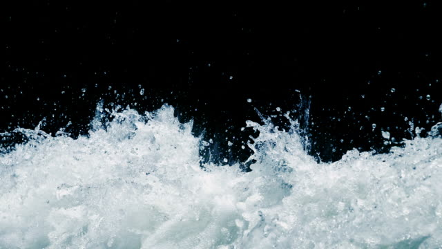 splashing water, slow motion - black background stock videos & royalty-free footage