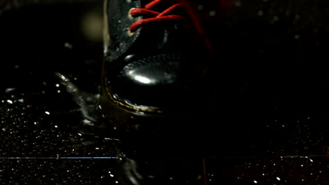splashing with boot on wet floor - boot stock videos & royalty-free footage
