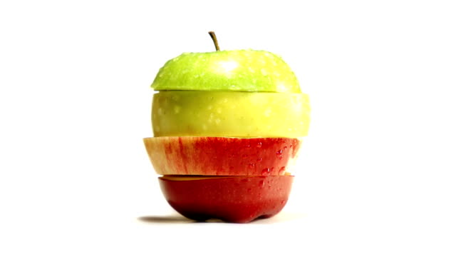 spliced apple - slice stock videos and b-roll footage
