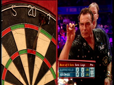 Split screen Bobby George scores 180 at the oche removes darts turns to supporters who cheer wildly 2003 Embassy World Darts Championships Lakeside...