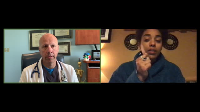 cu split screen of a doctor talking to a patient on video - bathrobe stock videos & royalty-free footage