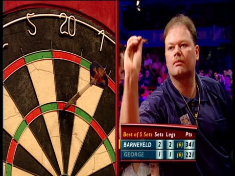stockvideo's en b-roll-footage met split screen on raymond van barneveld scoring 180 2003 embassy world darts championships frimley green lakeside - van