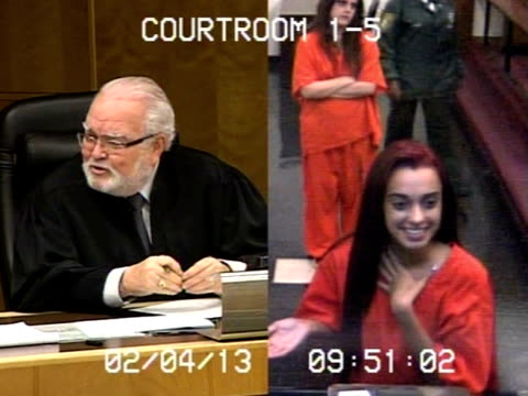 / split screen video of judge and defendant in courtroom / judge speaking to young woman as she is giggling / judge gets angry at woman and sets her... - obscene gesture stock videos and b-roll footage