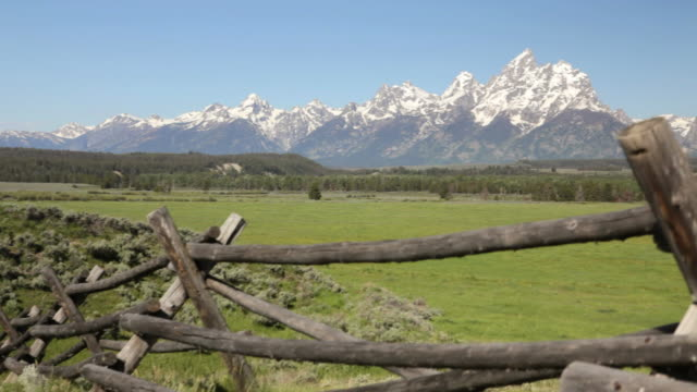 CS,  Split-rail wood fence and the Grand Tetons, Grand Teton National Park, Wyoming