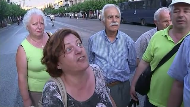 vídeos de stock e filmes b-roll de splits in government over planned bailout deal greece athens ext protesters along with placards middle aged and elderly protesters gathered on street... - athens greece