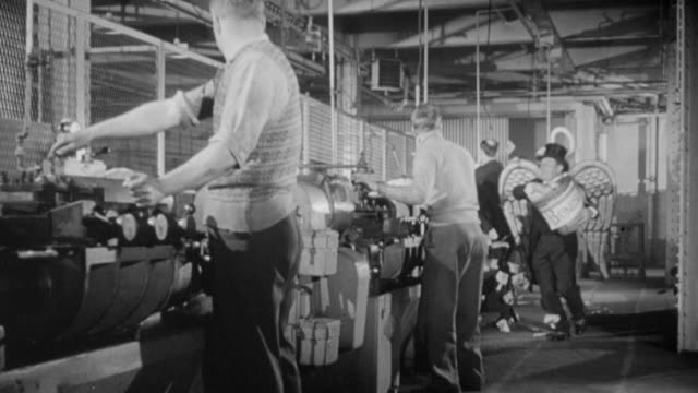 vídeos de stock, filmes e b-roll de 1957 ws spoof of factory workers at work stations being bestowed with bonuses by an angel winged, tuxedo wearing gentleman who showers the workers with paper bonuses as he skips and leaps along / united kingdom - bônus