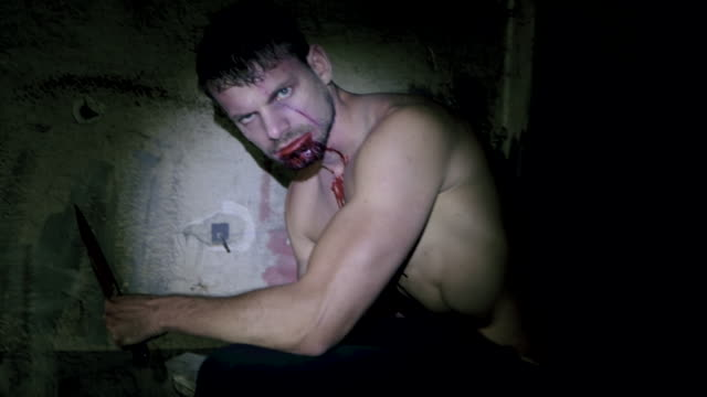 spooky portrait of man in dark room - zombie stock videos & royalty-free footage