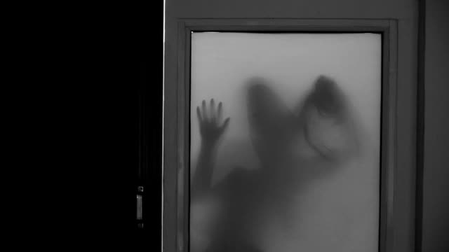 spooky silhouette of ghost woman behind the matte glass window - ghost stock videos and b-roll footage
