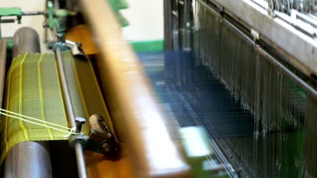 spool of colourful thread in retro classical style weaving machine - textile industry stock videos & royalty-free footage