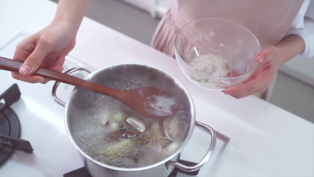 spoon dipping into a bowl and removing oil from broth - anchovy stock videos & royalty-free footage