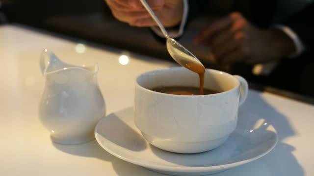 Spoon mixing coffee