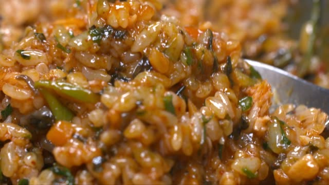 a spoonful of fried rice - fried rice stock videos and b-roll footage