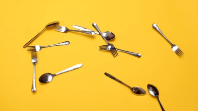 spoons and forks - yellow background stock videos & royalty-free footage