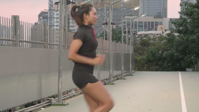 sport asian woman drill hi knee and warm up before running - drill stock videos & royalty-free footage