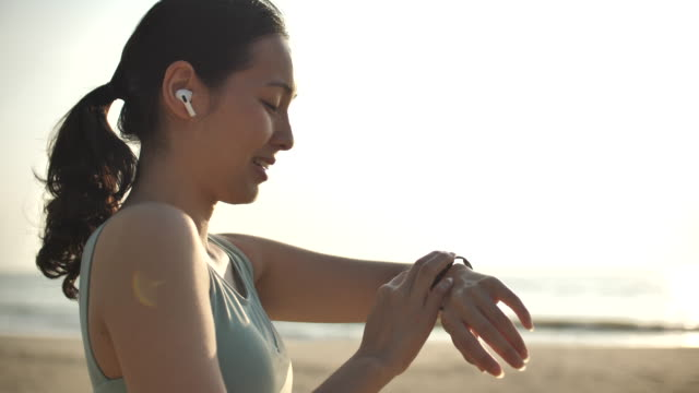 sport asian woman using smart watch - interval start stock videos & royalty-free footage