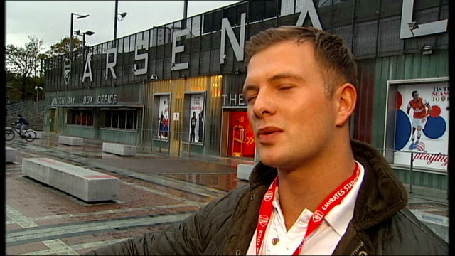BT Sport buys Champions League football rights ENGLAND London Emirates Stadium Reporter to camera Vox pop Arsenal Crest on wall PAN Sign 'Tis the...