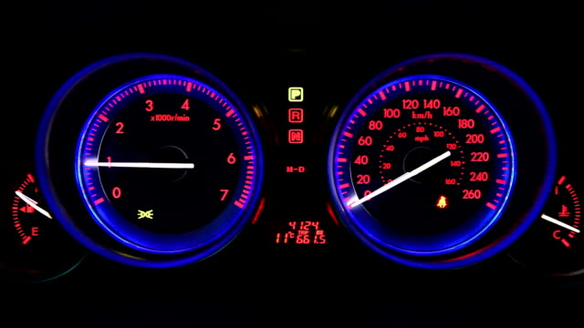 sport car dashboard illuminated at night - speedometer stock videos & royalty-free footage