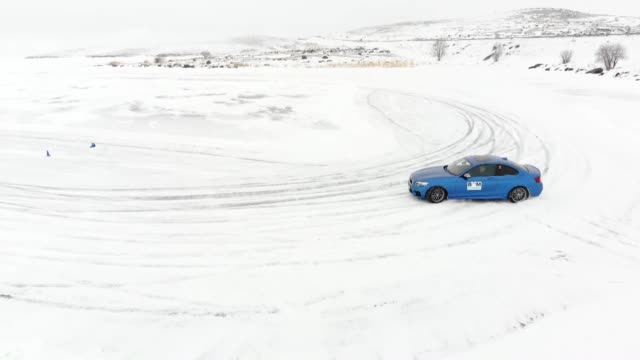 sport cars drift on the frozen lake cildir in kars province of northeastern turkey on february 14 2019 - kars stock videos & royalty-free footage