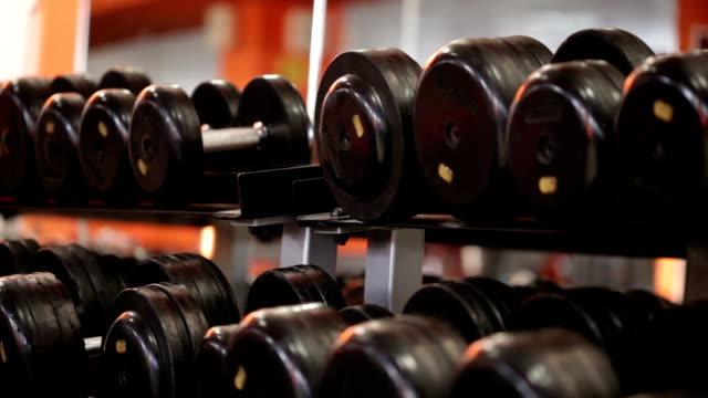 sport equipment -  dumbbells - exercise equipment stock videos and b-roll footage