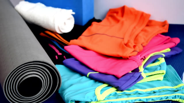 sport equipment on yoga mat / healthy lifestyle conceptual - still life stock videos and b-roll footage