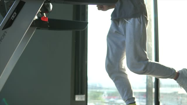 sport male running on treadmill in gym - human limb stock videos & royalty-free footage
