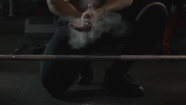 sport man does barbell exercise slow motion - talcum powder stock videos and b-roll footage