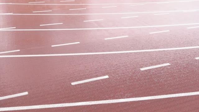 vídeos y material grabado en eventos de stock de pista deportiva en el día de lluvia - buena condición
