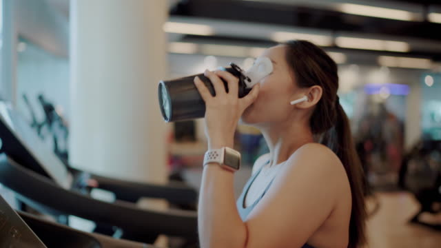 sport woman drinking a protein shake at gym - refreshment stock videos & royalty-free footage