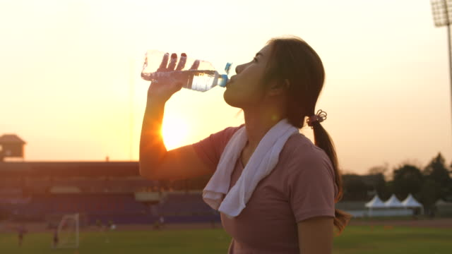 sport woman drinking water - protein drink stock videos & royalty-free footage