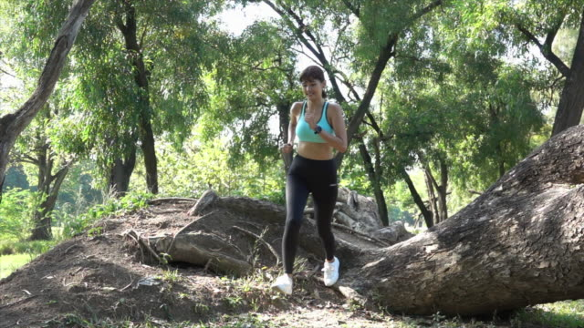 sport woman run in the country side slow motion - named wilderness area stock videos & royalty-free footage