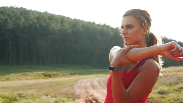 sport woman stretch, preparing for workout - cross country running stock videos & royalty-free footage