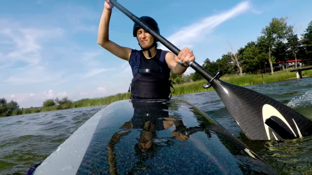 sport woman,kayaking,slow motion - using a paddle stock videos & royalty-free footage