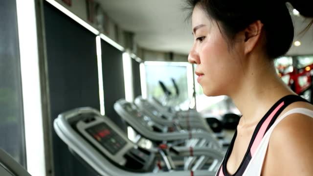 sport women running on treadmill cardio equipment - racewalking stock videos and b-roll footage